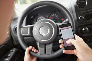 Chicago auto accident lawyer, distracted driving, handheld cell phones, hands-free device law, texting while driving, distracted driving cases, distracted driving laws, Illinois distracted driving, hands-free device